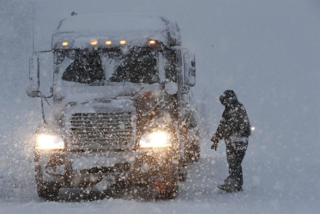 A truck worker in a snowstorm