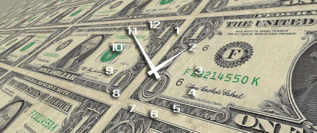 Clock and money represent real-time payroll
