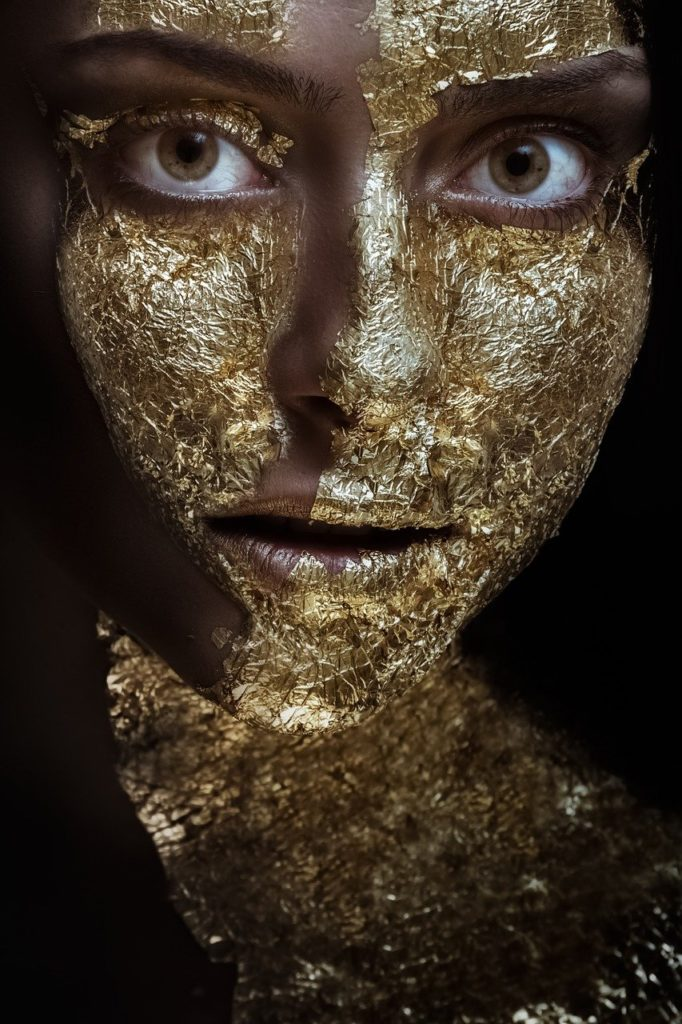 woman with gold face